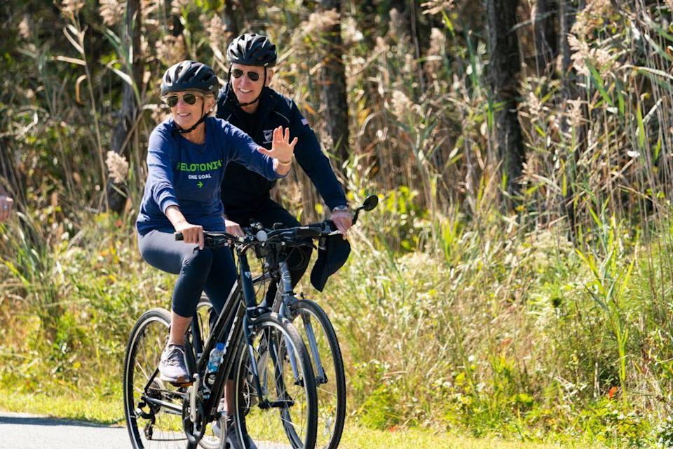 President Joe Biden and first lady Jill Biden ride their bikes on a trail at Gordons Pond in Rehoboth Beach, Del., Sunday, Sept. 19, 2021. Biden is spending the weekend at his Rehoboth Beach home. - Credit: AP