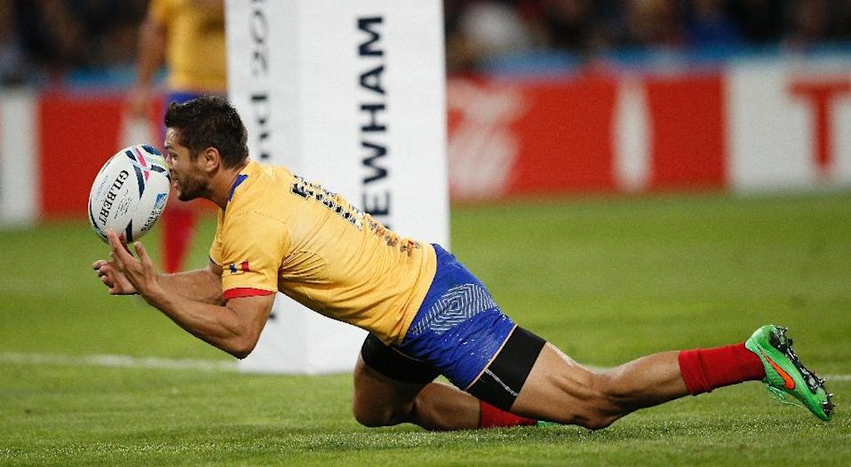 One Romania player who will be praying the Irish defence loses its focus will be Catalin Fercu, who requires just one try to become his country's record try-scorer (AFP Photo/Adrian Dennis)