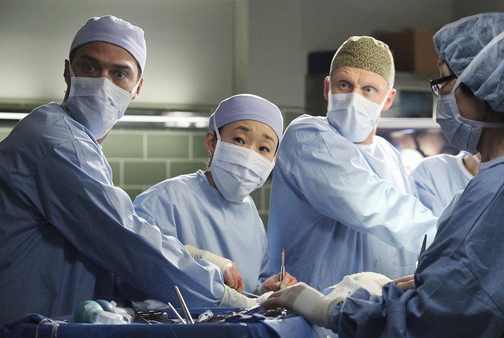 """Jesse Williams as Jackson Avery, Sandra Oh as Cristina Yang, and Kevin McKidd as Owen Hunt in the """"<a href=""""/grey-39-s-anatomy/show/36657"""">Grey's Anatomy</a>"""" musical episode, """"Song Beneath the Song."""""""