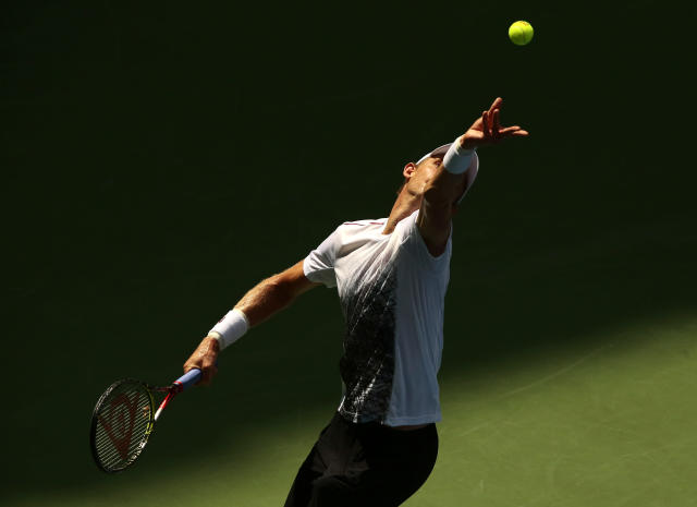 Kevin Anderson, of South Africa, serves to Dominic Thiem, of Austria, during the fourth round of the U.S. Open tennis tournament, Sunday, Sept. 2, 2018, in New York. (AP Photo/Andres Kudacki)