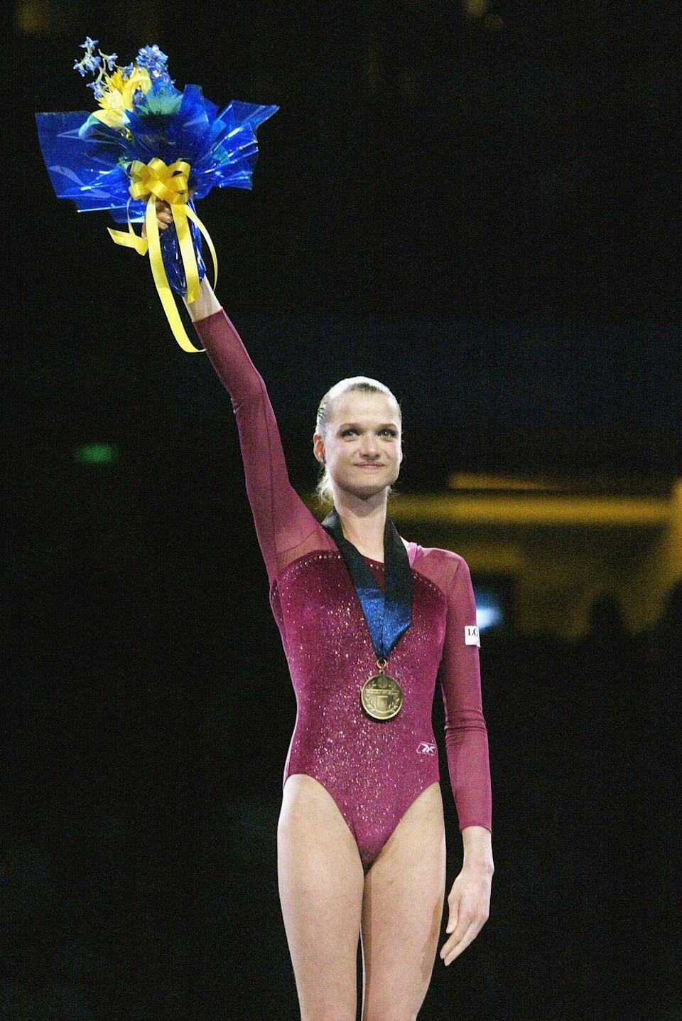 """<p>Russian gymnast Svetlana Khorkina was one of the most talented athletes in the late '90s and early 2000s. Due to her <a href=""""https://olympics.com/en/athletes/svetlana-khorkina"""" rel=""""nofollow noopener"""" target=""""_blank"""" data-ylk=""""slk:unusual height"""" class=""""link rapid-noclick-resp"""">unusual height</a> for the sport, Khorkina had to develop several of her own unique moves—but that didn't stop her from taking home seven Olympic medals over three Olympic Games. </p>"""