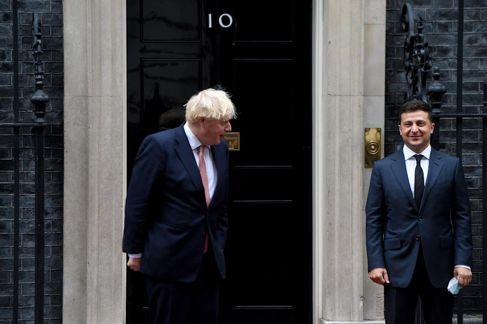 LONDON, ENGLAND - OCTOBER 08: Britain's Prime Minister Boris Johnson (L) greets President of Ukraine Volodymyr Zelensky outside number 10 Downing Street prior to their meeting in London, United Kingdom on October 8, 2020. (Photo by Kate Green/Anadolu Agency via Getty Images)