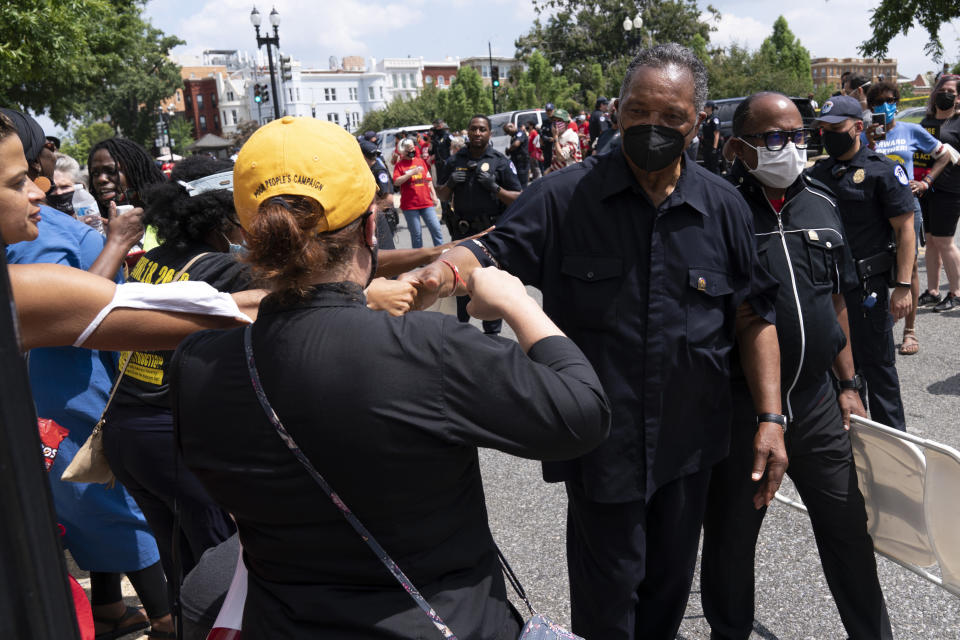 Rev. Jesse Jackson shake hands with supporters as they protest outside of the Hart Senate Office Building, during demonstration supporting the voting rights, on Capitol Hill, in Washington, Monday, Aug. 2, 2021. (AP Photo/Jose Luis Magana)