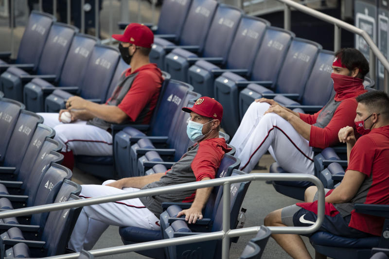 Washington Nationals players sitting in the stands.