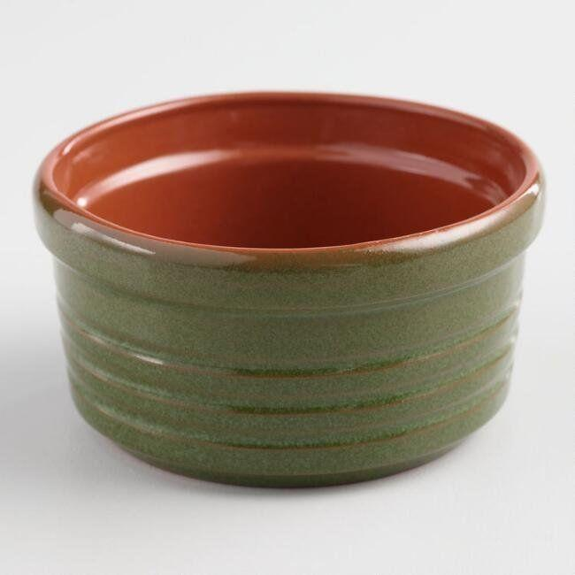 "This <a href=""https://www.worldmarket.com/product/green-reactive-glaze-terracotta-ramekin.do?sortby=ourPicks&from=Search"" target=""_blank"">green ramekin</a> is ideal for oven-to-table serving."