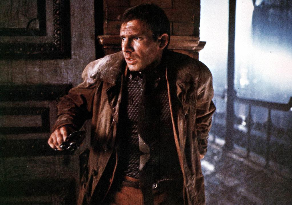 """<a href=""""http://movies.yahoo.com/movie/1800037822/info"""">Blade Runner</a> (1982): Ridley Scott's film is a sci-fi classic, and Ford anchors it with stoic, film-noir cool. He stars as Rick Deckard, a retired Los Angeles detective in the year 2019 who's called back into duty to seek out and terminate rebel replicants. Based on a Philip K. Dick novel, """"Blade Runner"""" is all about mood and production design -- a dank, futuristic dystopia that's since become hugely influential. But Ford brings a much-needed sense of complex humanity to this dark spectacle."""