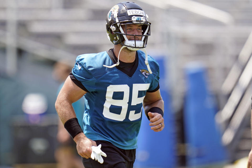 Jacksonville Jaguars tight end Tim Tebow runs on the field during an NFL football team practice, Thursday, May 27, 2021, in Jacksonville, Fla. (AP Photo/John Raoux)
