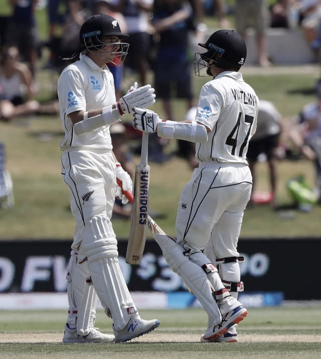 New Zealand's Mitchell Santner, left, is congratulated by teammate BJ Watling after scoring his century (Mark Baker/AP)
