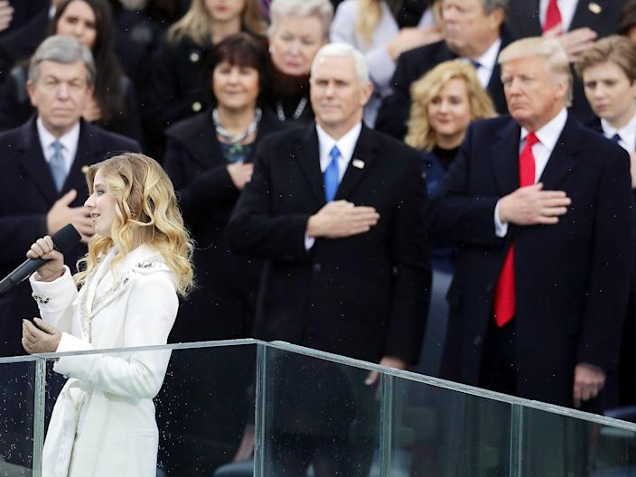 Jackie Evancho performs the National Anthem as Vice President Mike Pence and President Donald Trump watch (Getty)