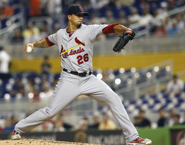 St. Louis Cardinals starter Kyle Lohse throws to the Miami Marlins during the first inning of a baseball game in Miami, Tuesday, June 26, 2012. (AP Photo/J Pat Carter)