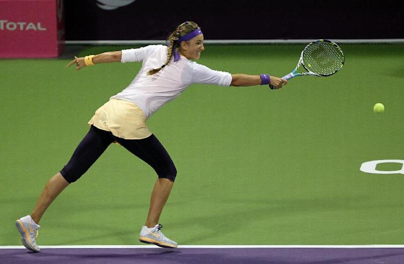Belarus' Victoria Azarenka returns the ball to Agnieszka Radwanska of Poland in the semifinal of the WTA Qatar Ladies Open tennis tournament in Doha, Qatar, Saturday, Feb. 16, 2013. (AP Photo/Osama Faisal)