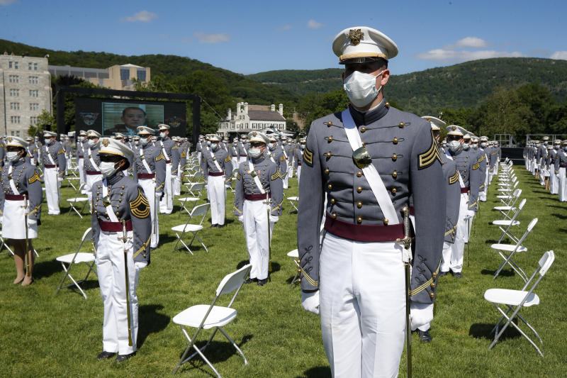WEST POINT, NY - JUNE 13: West Point graduating cadets wear personal protective equipment as they gather at their seats during commencement ceremonies at Plain Parade Field at the United States Military Academy on June 13, 2020 in West Point, New York. U.S. President Donald Trump addressed the graduating class of 1,107 cadets during a socially-distanced ceremony held amid the COVID-19 pandemic. (Photo by John Minchillo-Pool/Getty Images)