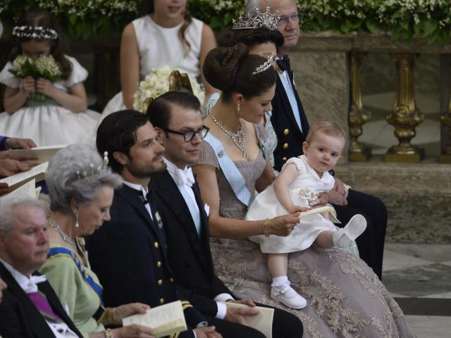 From right, Sweden's King Carl Gustaf, Queen Silvia, Crown Princess Victoria with Princess Estelle, Prince Daniel and Prince Carl Philip attend the wedding ceremony of Princess Madeleine and Christopher O'Neill at the Royal Chapel in Stockholm, Saturday June 8, 2013. (AP Photo/Anders Wiklund) SWEDEN OUT