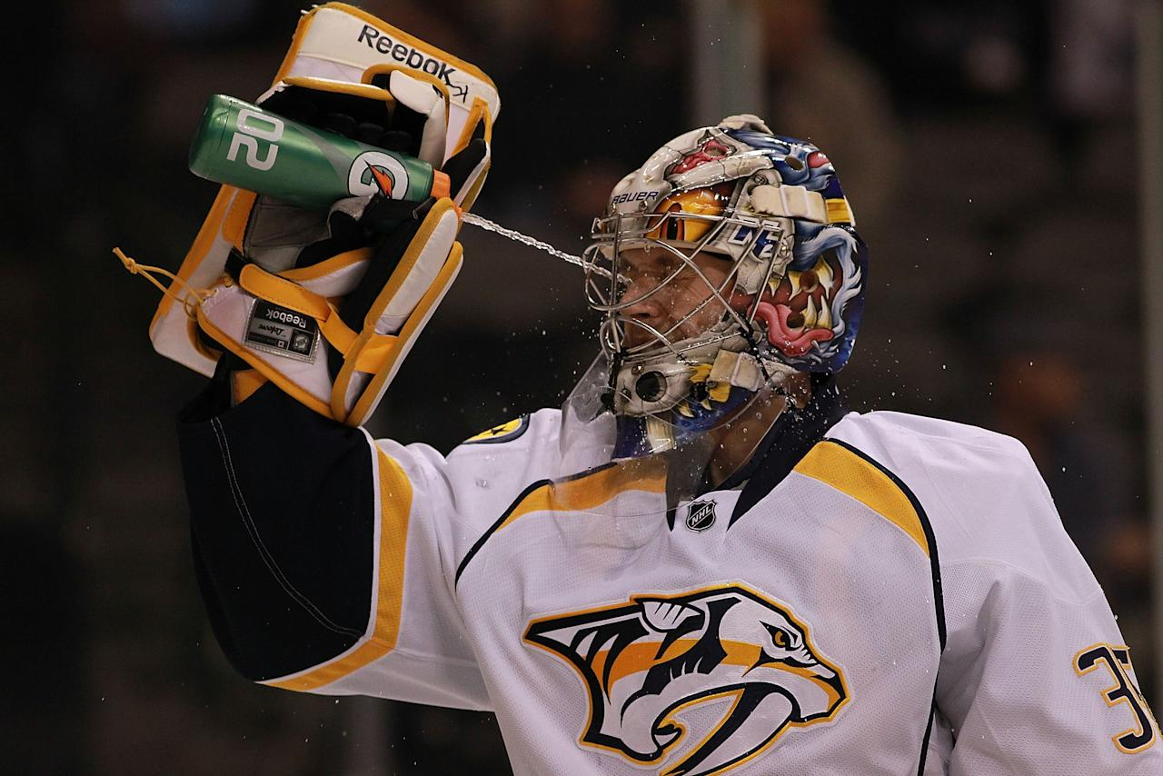 DALLAS, TX - FEBRUARY 19:  Pekka Rinne #35 of the Nashville Predators sprays water before a game against the Dallas Stars at American Airlines Center on February 19, 2012 in Dallas, Texas.  (Photo by Ronald Martinez/Getty Images)