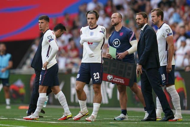 England substitutes Mason Mount (left), Jack Grealish (centre) and Harry Kane prepare to come on