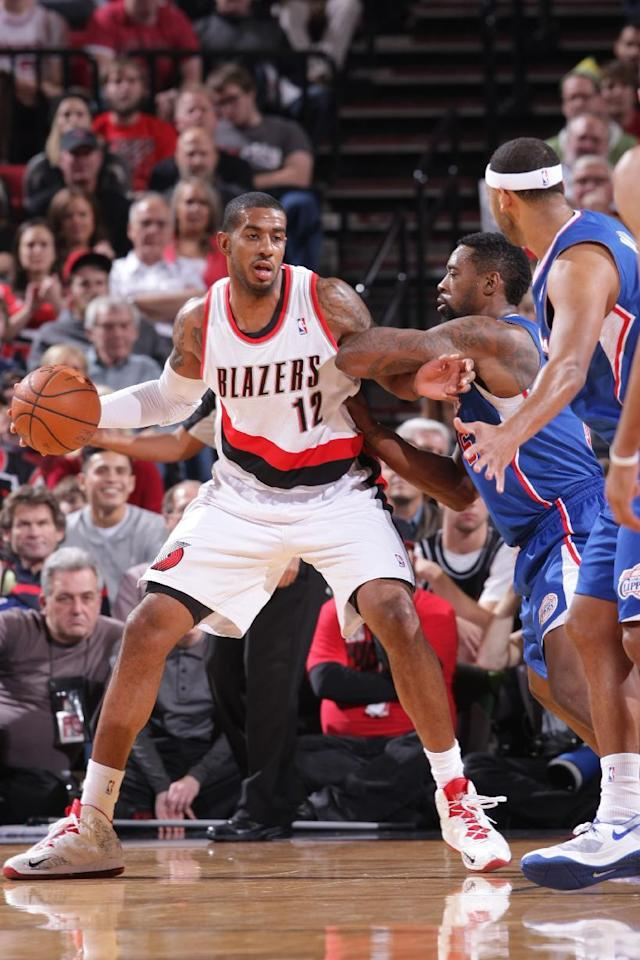 PORTLAND, OR - DECEMBER 26: LaMarcus Aldridge #12 of the Portland Trail Blazers looks on against the Los Angeles Clippers on December 26, 2013 at the Moda Center Arena in Portland, Oregon. (Photo by Sam Forencich/NBAE via Getty Images)