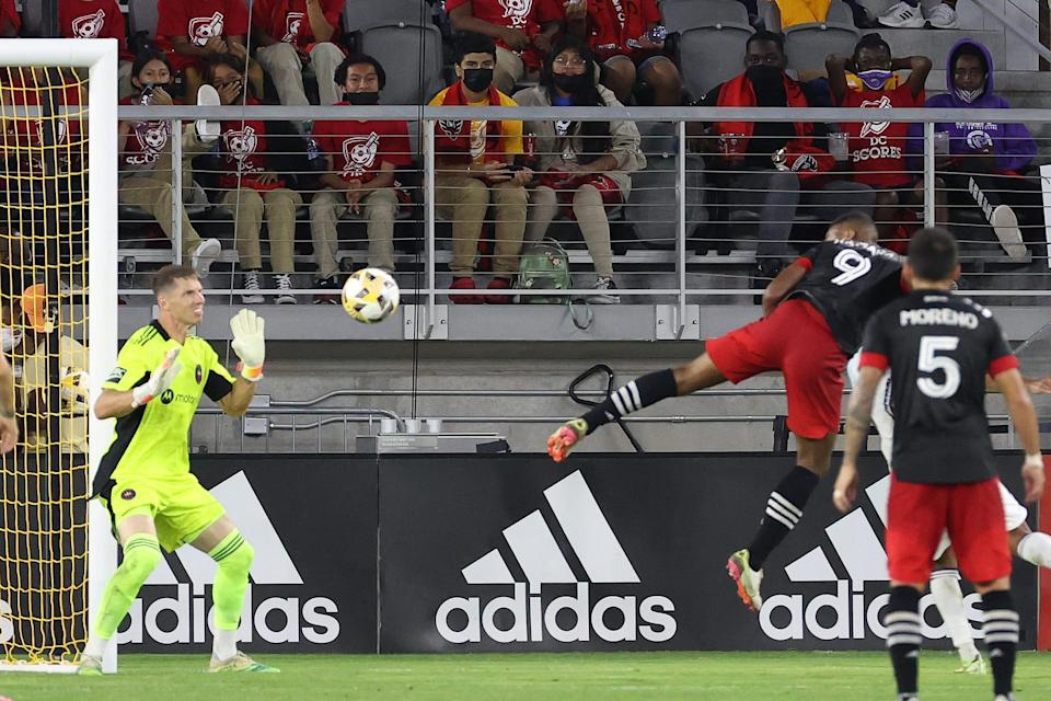 D.C. United's Ola Kamara (9) scores on a header past Chicago Fire FC goalkeeper Bobby Shuttleworth in the first half at Audi Field. Kamara scored all three goals in D.C. United's 3-0 win.