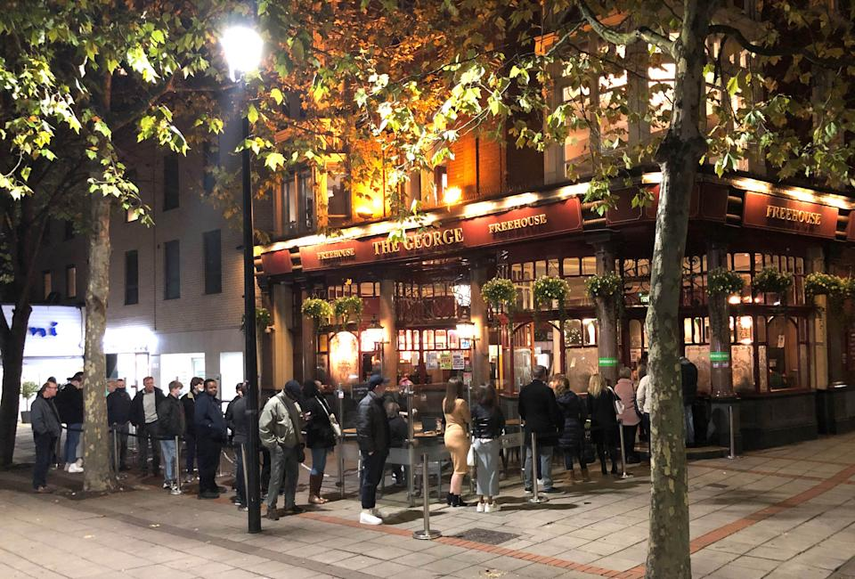 File photo dated 04/11/20 of people queuing to get into the The George pub in Wanstead, east London. Pub landlords could be allowed to require customers to provide proof they are vaccinated against coronavirus, according to Boris Johnson. Issue date: Wednesday March 24, 2021.