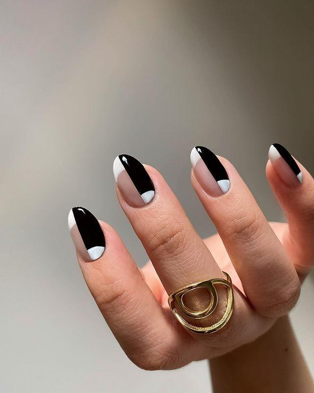 """<p>Half <a href=""""https://www.cosmopolitan.com/style-beauty/beauty/news/a55219/the-french-tip-spring-nail-trend-that-isnt-basic/"""" rel=""""nofollow noopener"""" target=""""_blank"""" data-ylk=""""slk:French manicure"""" class=""""link rapid-noclick-resp"""">French manicure</a>, half half-moon nails, this black-and-white design is <strong>all about pairing opposites together</strong> and looking damn good while doing it. </p><p><a href=""""https://www.instagram.com/p/B_JM_N-D_I0/?utm_source=ig_embed&utm_campaign=loading"""" rel=""""nofollow noopener"""" target=""""_blank"""" data-ylk=""""slk:See the original post on Instagram"""" class=""""link rapid-noclick-resp"""">See the original post on Instagram</a></p>"""