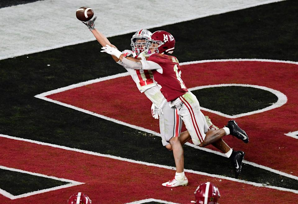 Alabama's Brian Branch (14) broke up a pass intended for Ohio State wide receiver Jaxon Smith-Njigba in last season's national championship game.