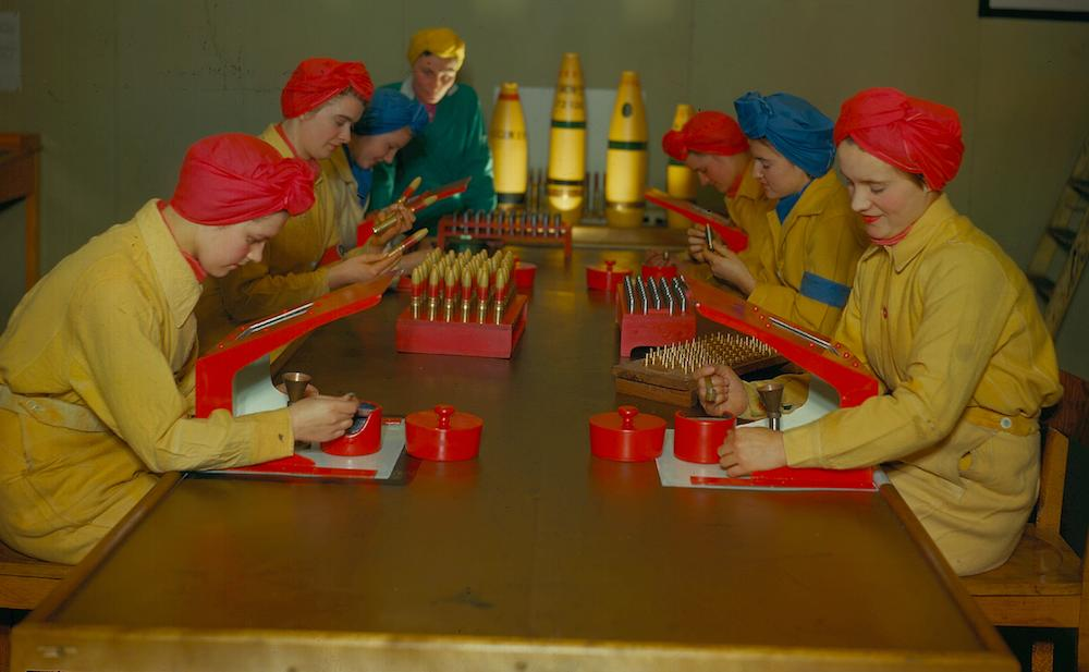 <p>We've all read the history books (hopefully): when the men went off to war, the women stepped up at home and filled in. Their role was actually instrumental on the ba tlefield as well. At the Royal Ordinance Factory in England, female workers in brightly-colored turbans made dummy explosives at a munitions factory in yellow jumpsuits. <i>Photo: Getty Images</i></p>
