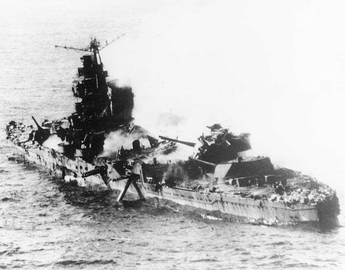 FILE - In this May 1942 file photo a Japanese heavy cruiser of the Mogami class lies low in the water after being bombed by U.S. naval aircraft during the Battle of Midway. Researchers scouring the world's oceans for sunken World War II ships are honing in on debris fields deep in the Pacific. A research vessel called the Petrel is launching underwater robots about halfway between the U.S. and Japan in search of warships from the Battle of Midway. (AP Photo, File)