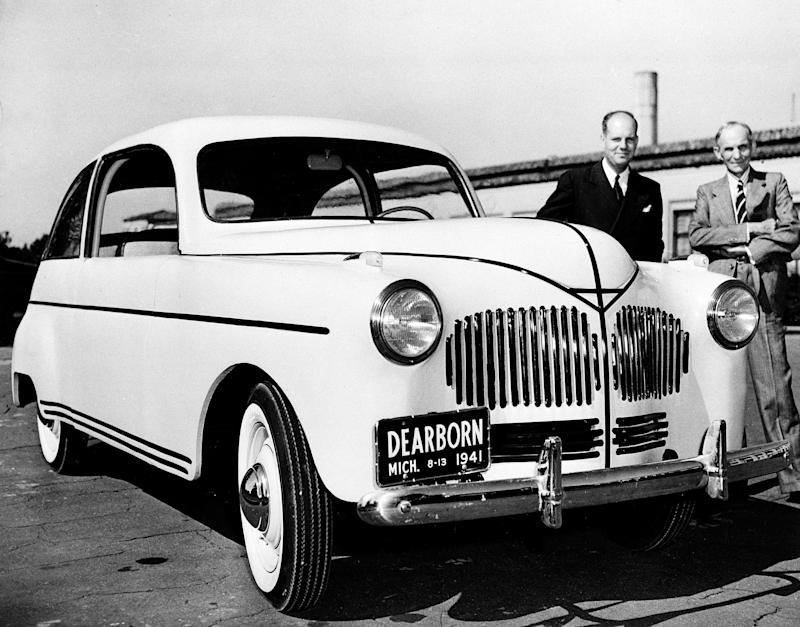 Ford Motor Company founder Henry Ford, right, unveils his new plastic automobile, developed from agricultural products, in Dearborn, Mich., Aug. 13, 1941. Robert A. Boyer, in charge of Ford Plastics development, is at left. The experimental, handmade automobile has a plastic body made from soybean and fibers such as field straw, hemp and flax. The car runs on gasoline and corn-derived ethanol. (AP Photo)
