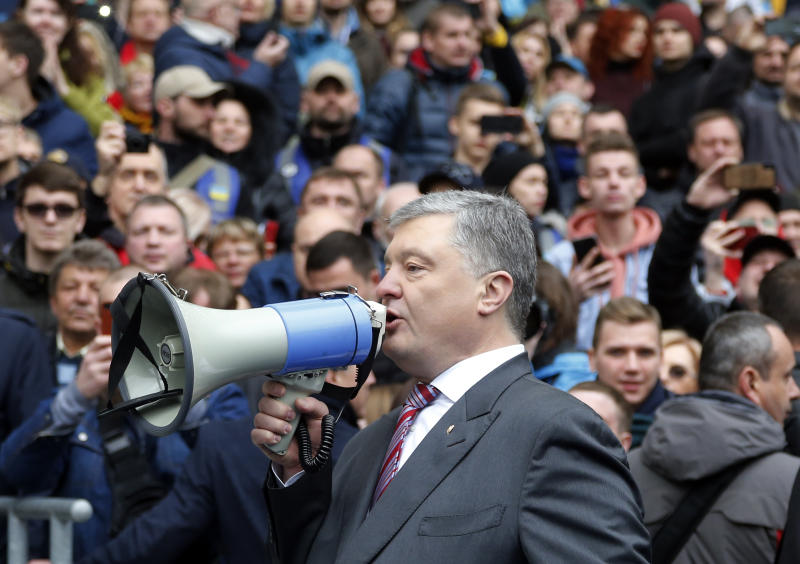 FILE - In this Sunday, April 14, 2019 file photo, Ukrainian President Petro Poroshenko talks to his supporters ahead of the presidential elections, at the Olympic stadium in Kiev, Ukraine. Ukraine's presidential runoff on Sunday, April 21, is a battle between a billionaire tycoon who rode anti-Russian protests to the nation's top office five years ago, and a comedian who plays a president in a TV sitcom. The actor has used humor and social media to take pole position. (AP Photo/Efrem Lukatsky, file)