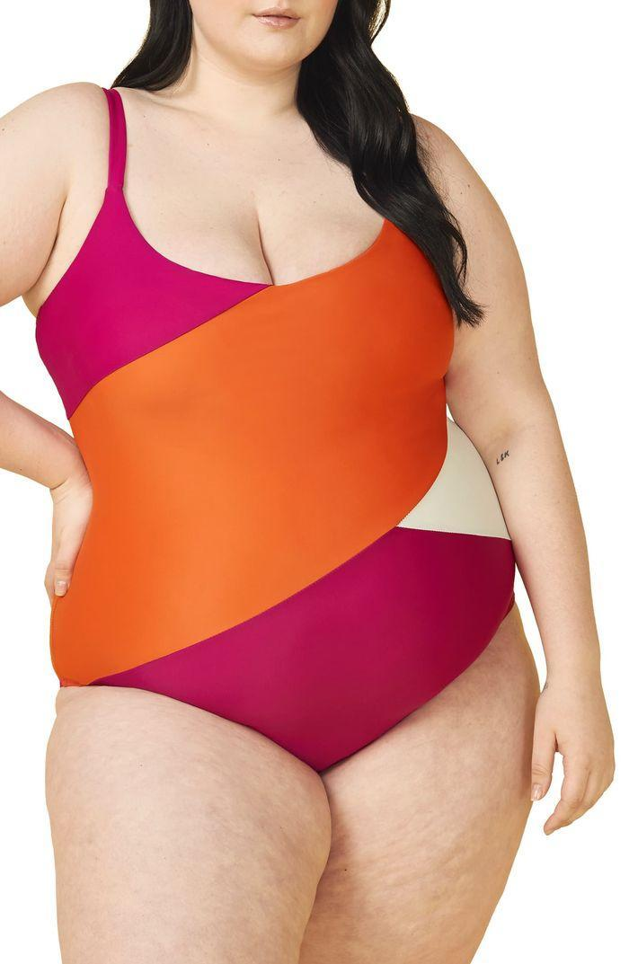 """<strong><h4>Summersalt</h4></strong><br><strong>Size range</strong><br>UK6 - UK26<br><br>Cool colour block design? Check. Built-in cups? Check. Adjustable straps? Check. This Summersalt design is a super flattering and stylish take on the one-piece and comes in seven other colourways and patterns.<br><br><strong>Summersalt</strong> The Marina, $, available at <a href=""""https://www.summersalt.com/collections/sizes-16-22/products/the-marina-lava-hibiscus-white-sand"""" rel=""""nofollow noopener"""" target=""""_blank"""" data-ylk=""""slk:Summersalt"""" class=""""link rapid-noclick-resp"""">Summersalt</a>"""