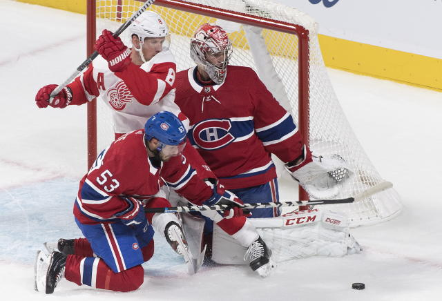 Detroit Red Wings' Justin Abdelkader (8) moves in against Montreal Canadiens goaltender Carey Price as Canadiens' Victor Mete defends during first-period NHL hockey game action in Montreal, Thursday, Oct. 10, 2019. (Graham Hughes/The Canadian Press via AP)