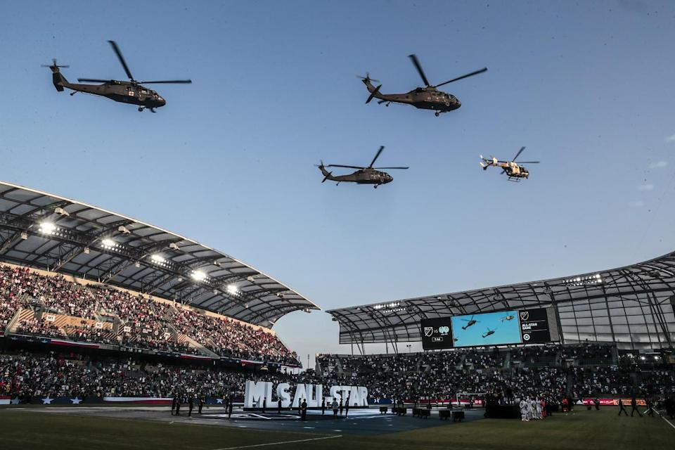 Helicopters fly over the stadium during pregame festivities as the MLS All-Star game