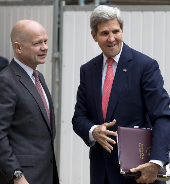 Britain Foreign Secretary William Hague, left, greets US Secretary of State John Kerry outside the Foreign Office in London,Monday, Sept. 9, 2013. (AP Photo/Alastair Grant, Pool)