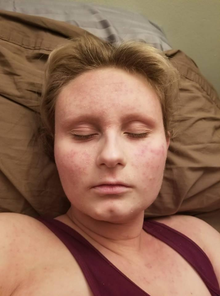 woman lying in bed with her eyes closed