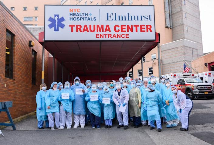 """<span class=""""caption"""">Compassion and solidarity on display at New York's Elmhurst Hospital, during the April peak of the city's coronavirus outbreak.</span> <span class=""""attribution""""><a class=""""link rapid-noclick-resp"""" href=""""https://www.gettyimages.com/detail/news-photo/medical-workers-pose-for-a-photo-with-thank-you-signs-news-photo/1220057734?adppopup=true"""" rel=""""nofollow noopener"""" target=""""_blank"""" data-ylk=""""slk:Noam Galai/Getty Images"""">Noam Galai/Getty Images</a></span>"""