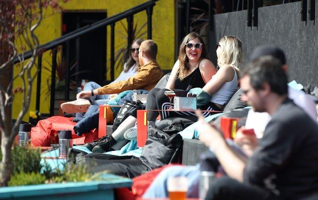Customers enjoy a drink at the Escape to Freight Island bar in Depot Island, Manchester (Martin Rickett/PA)