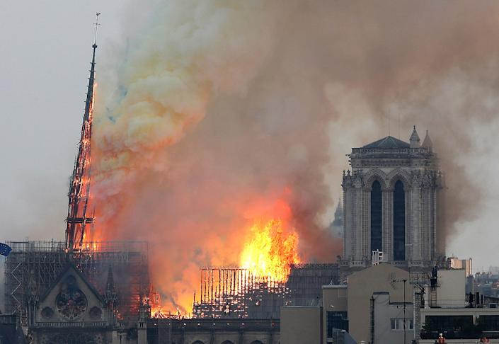 Flames rise from Notre Dame cathedral as it burns in Paris, Monday, April 15, 2019. Massive plumes of yellow brown smoke is filling the air above Notre Dame Cathedral and ash is falling on tourists and others around the island that marks the center of Paris. (Photo: Thibault Camus/AP)
