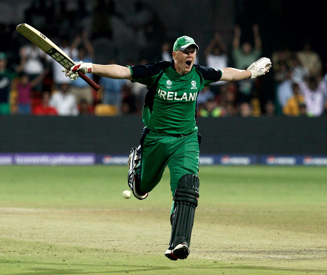 BANGALORE, INDIA - MARCH 02:  Kevin O'Brien of Ireland celebrates scoring a century batting against England in the Group B  2011 ICC World Cup match between England and Ireland at M. Chinnaswamy Stadium on March 2, 2011 in Bangalore, India.  (Photo by Graham Crouch/Getty Images)