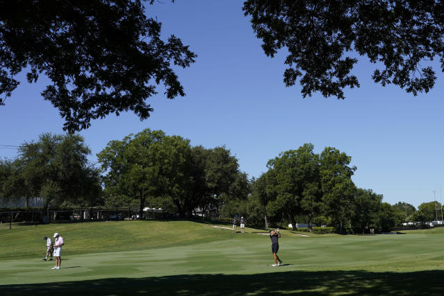 Jordan Spieth hits from the 15th fairway during practice for the Charles Schwab Challenge golf tournament at the Colonial Country Club in Fort Worth, Texas, Wednesday, June 10, 2020. (AP Photo/David J. Phillip)