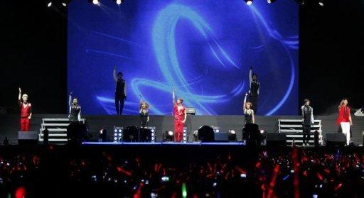 Image provided by C-JeS Entertainment shows South Korean boyband JYJ performing in Lima, Peru, on March 11. Latin American fans have posted hundreds of videos on YouTube showing flash mobs emulating K-pop dance moves and urging their favourite stars to visit the continent