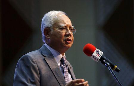 Malaysia's Prime Minister Najib Razak announces revisions to the fiscal budget in Putrajaya