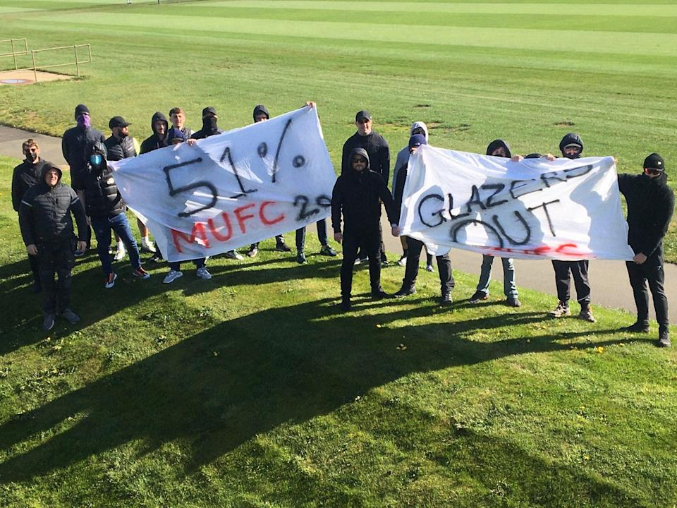 <p>The protesters gained access to the first team pitch</p> (@RedIssue Twitter)