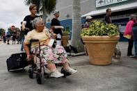 Residents of the surrounding communities arrive at the Germain Arena to seek shelter in preparation for Hurricane Irma in Estero, Florida, U.S., September 9, 2017. REUTERS/Bryan Woolston