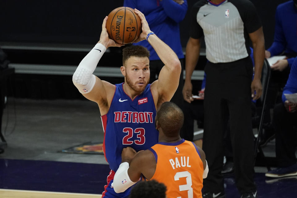 Detroit Pistons forward Blake Griffin (23) looks to pass over Phoenix Suns guard Chris Paul (3) during the first half of an NBA basketball game, Friday, Feb. 5, 2021, in Phoenix. (AP Photo/Matt York)