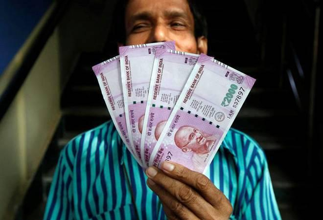 The Indian rupee opened weak at the interbank forex market on Wednesday and declined by 16 paise to 69.10 against the US dollar, amid sustained foreign fund outflows and rising crude oil prices.