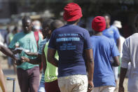 In this Tuesday, April 7, 2020 photo, a man wears a T- shirt with an advertisement regarding contraceptives, in Harare. Lockdowns imposed to curb the coronavirus' spread have put millions of women in Africa, Asia and elsewhere out of reach of birth control and other sexual and reproductive health needs. Confined to their homes with husbands and others, they face unwanted pregnancies and little idea of when they can reach the outside world again. (AP Photo/Tsvangirayi Mukwazhi)