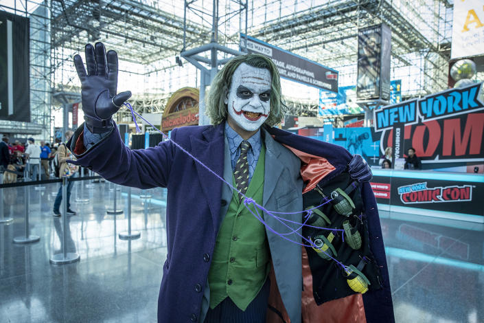 A cosplayer dressed as The Joker looks prepared to pull strings attends the New York Comic Con 2019  at Jacob Javits Center on Oct. 5, 2019 in New York City. (Photo: Gordon Donovan/Yahoo News)