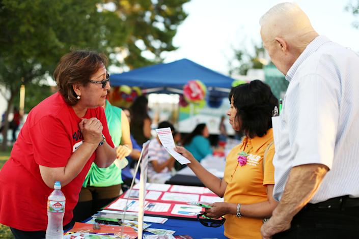 University of Arizona Center for Rural Health navigator Maria Losoya gives people information and answers on health insurance at the Celebración de la Independencia de Mexico in Tucson, Ariz., in September. (Photo: Caitlin O'Hara/Reuters)