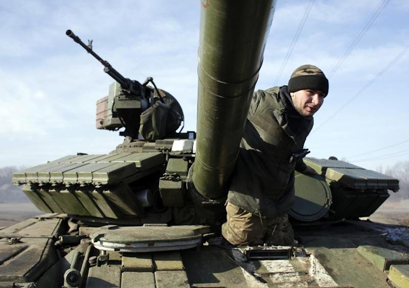 A Ukrainian serviceman climbs out of a tank at a checkpoint near Horlivka, in the Donetsk region, on February 23, 2015 (AFP Photo/Anatolii Stepanov)