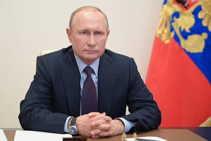 Russia's President Vladimir Putin is seen in his office in the Novo-Ogaryovo residence as he chairs a government meeting via videoconference link to discuss measures aimed at supporting Russia's economy and public services during the pandemic of the novel coronavirus disease on May 6, 2020.