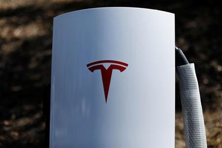 A newly installed car charger at a Tesla Super Charging station is shown in Carlsbad, California